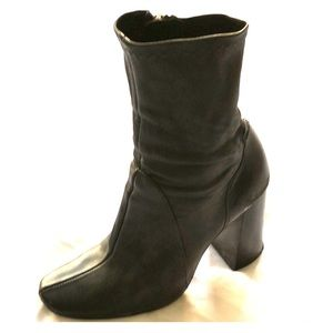 Black leather heeled boots by Zara